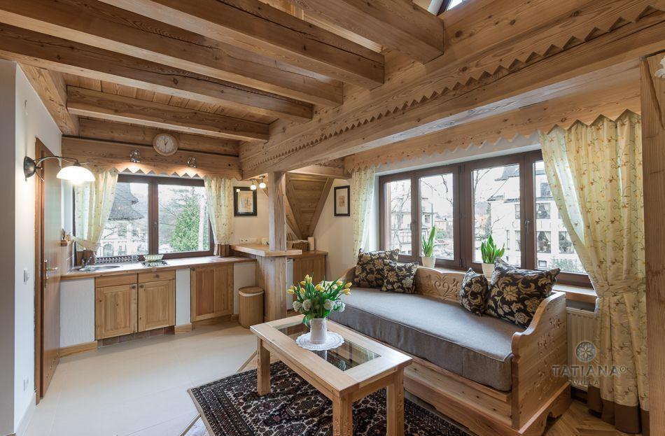 Apartament 8 Tatiana Premium Zakopane drewniany salon z aneksem kuchennym